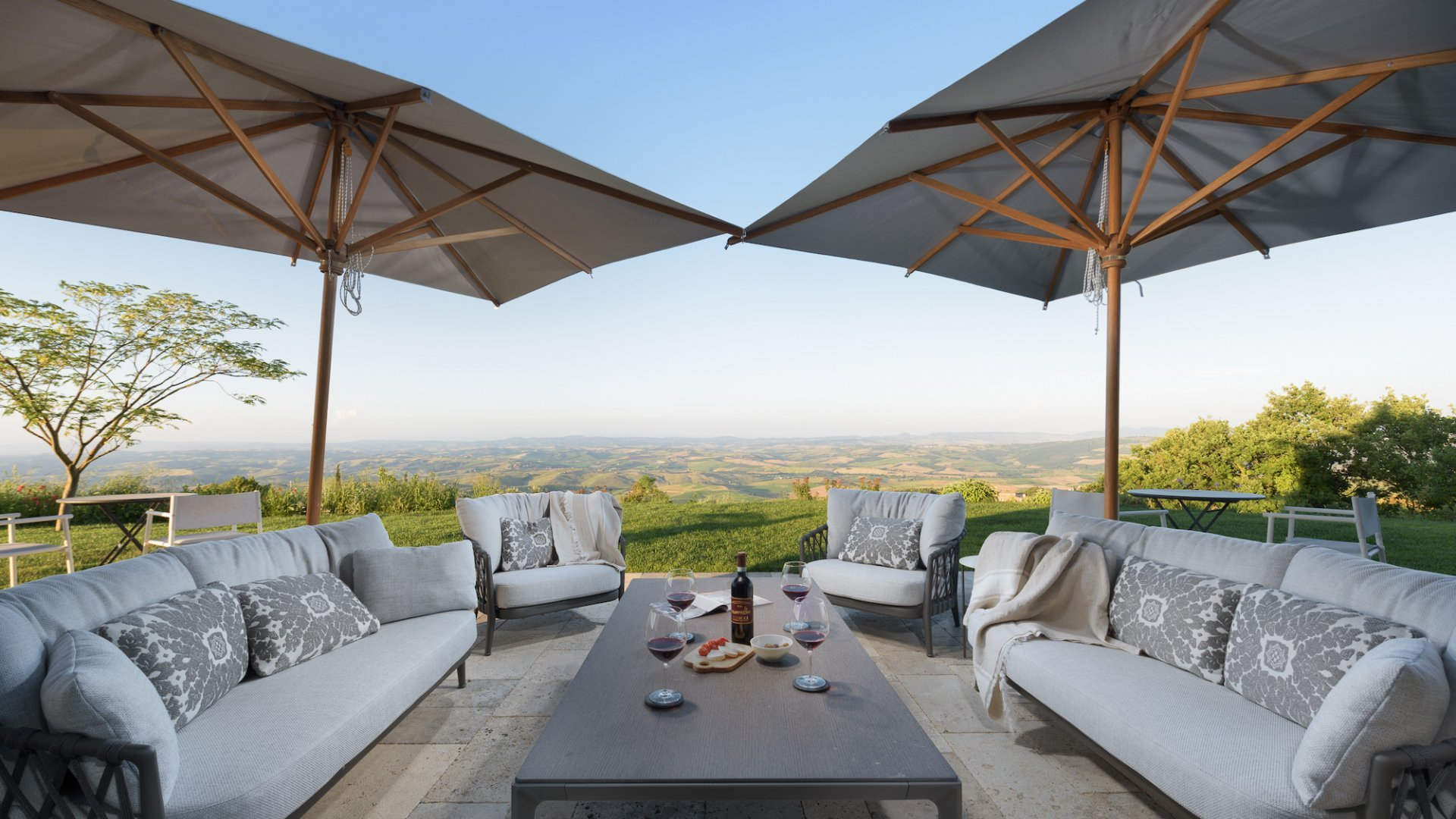 outdoor lounge area with view over the Tuscan hills