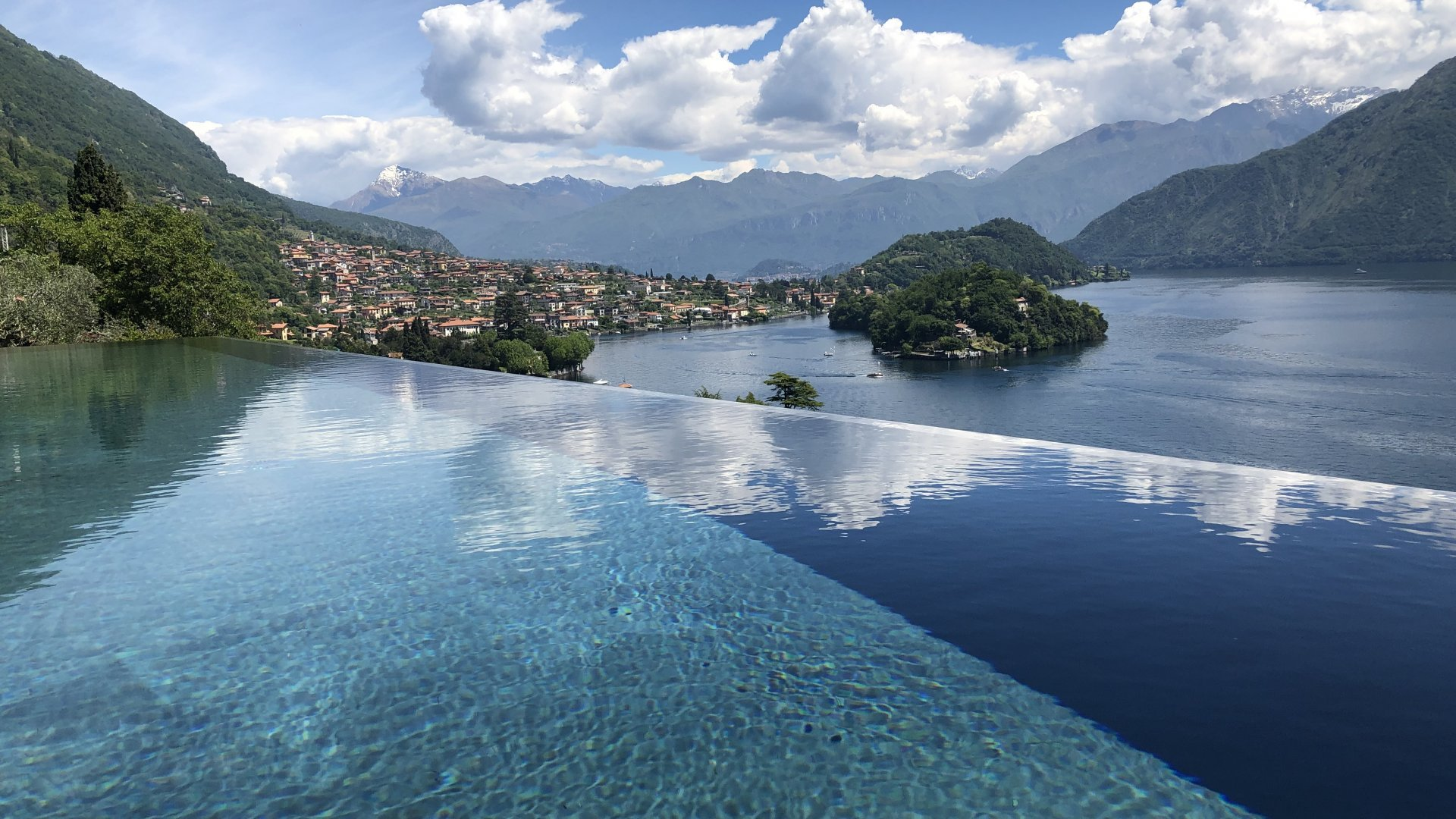 private infinity swimming pool with lake view