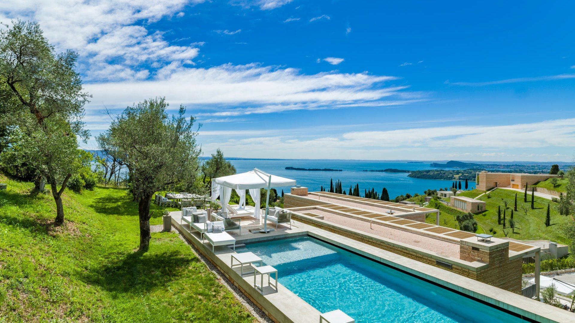 luxury swimming pool with view on Garda lake